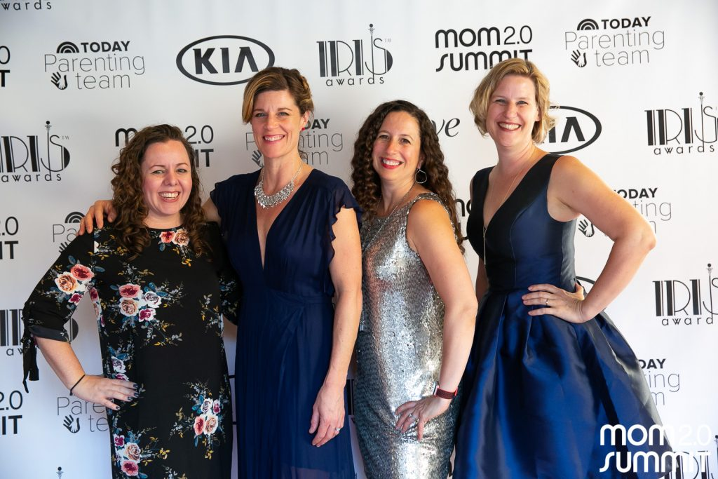 Standing with three other bloggers on the red carpet dressed up for the Iris Awards for writing