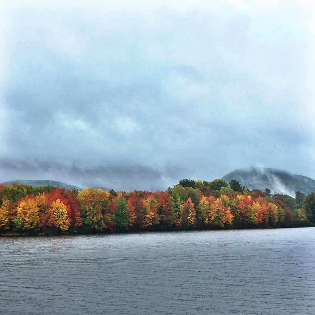 Trees explode in colors of gold and crimson as autumn arrives on Lake St. Catherine.