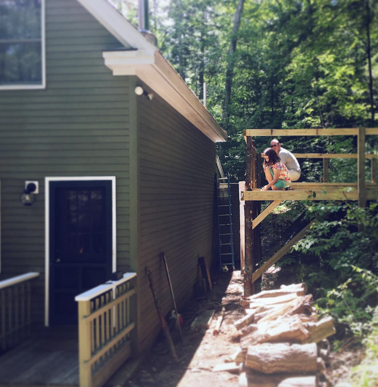 Finley and her dad work on a deck construction project.