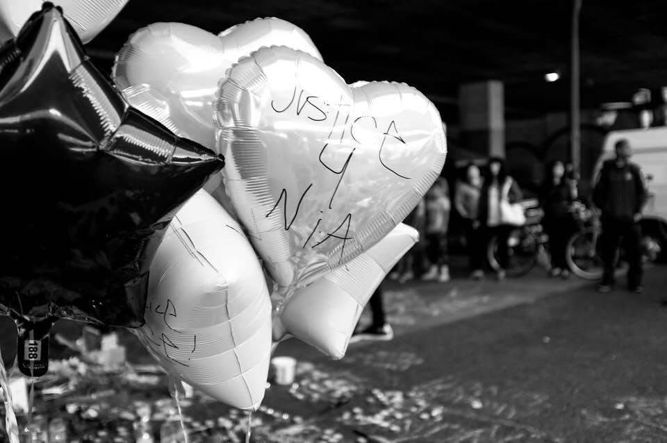 Justice for Nina written on heart shaped balloon.
