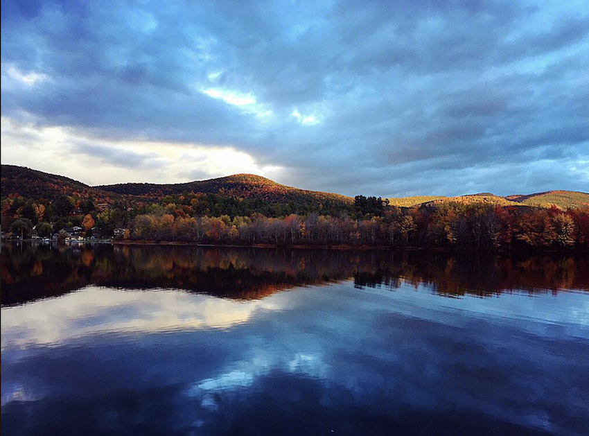 A mountainous Vermont landscape reflected in Lake St. Catherine.