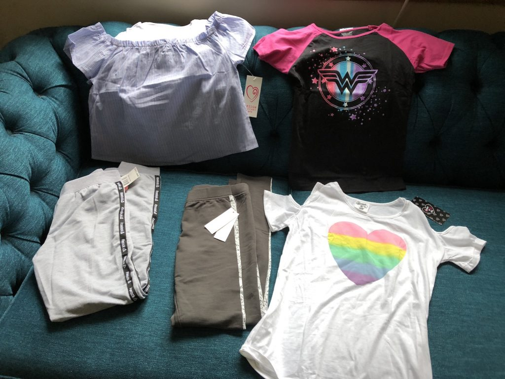 Three shirts and two pairs of pants from a subscription called Kidsbox.