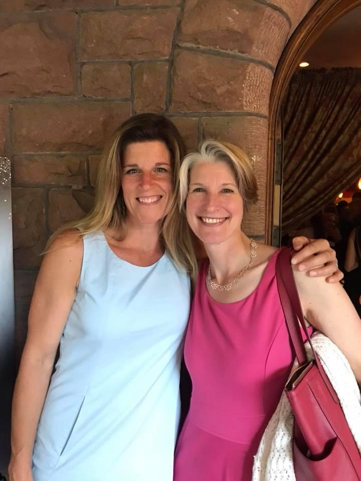 Amanda Magee and Emily Martz stand on porch of Morgan & Company in Glens Falls, NY