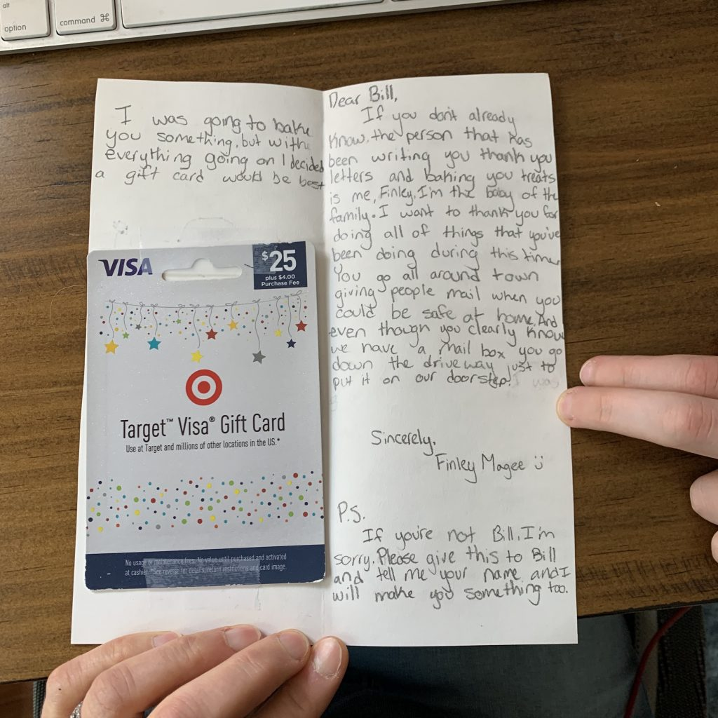 Shows a handwritten letter with a $25 gift card for the mailman